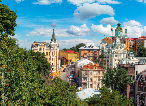 Staande foto Kiev Andrew descent, Andriyivski uzviz with ancient buildings and famous St. Andrew or Andriivska Church, historical district of Kyiv city in Ukraine