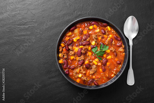 Leinwand Poster Traditional mexican dish chili con carne with minced meat and red beans