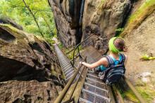 Girl Hiking On Steep Stairs In Bohemian-Saxon Switzerland Hiking Area, Germany