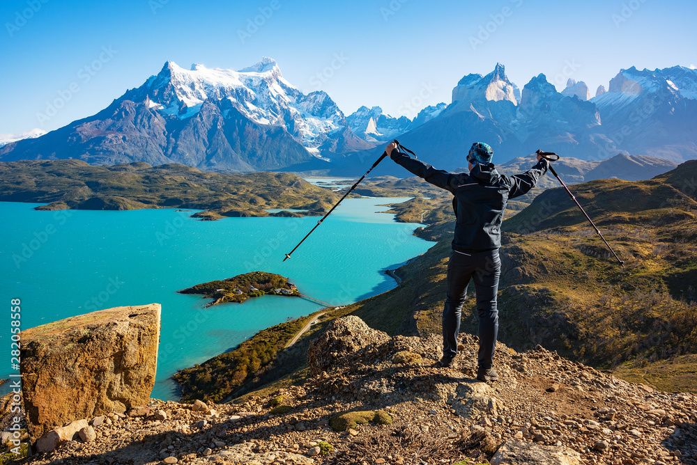 Fototapety, obrazy: Hiker at mirador condor enjoying amazing view of Los Cuernos rocks and Lake Pehoe in Torres del Paine national park, Patagonia, Chile