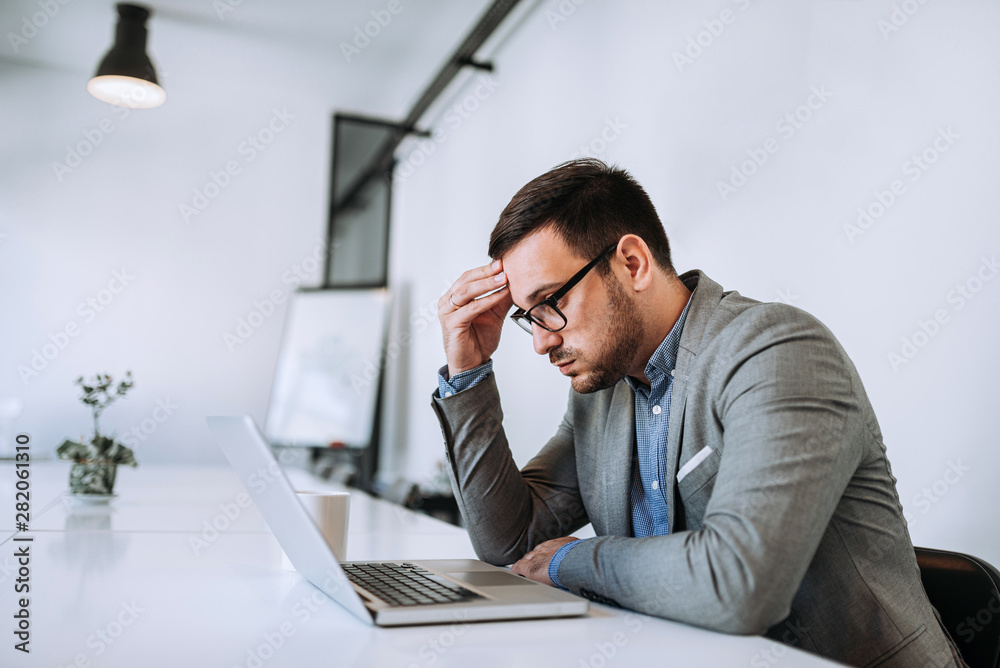 Fototapeta Businessman stressed out at work in casual office