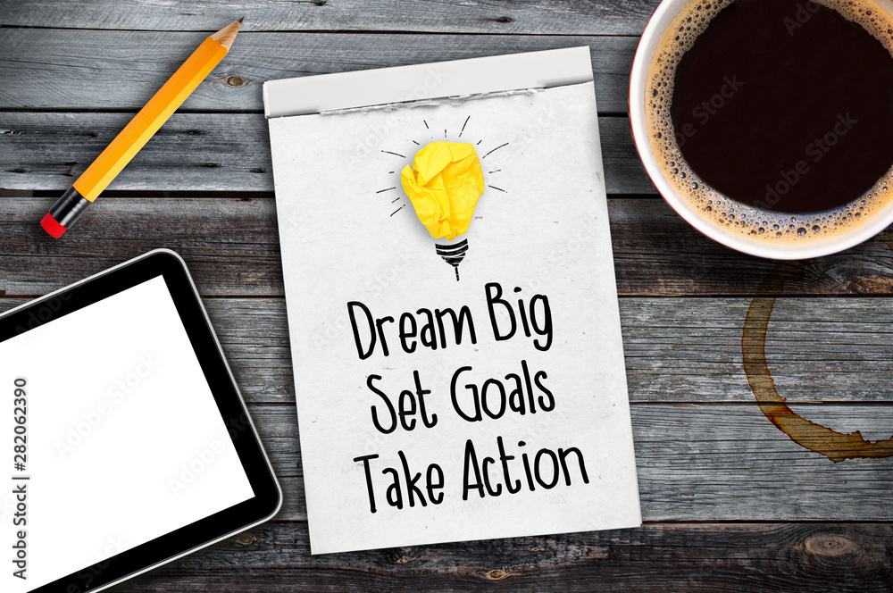 Fototapety, obrazy: Sketchbook with Dream big, set goals, take action on a wooden desk with coffee, pen and tablet