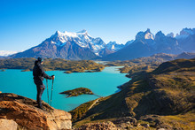 Hiker At Mirador Condor Enjoying Amazing View Of Los Cuernos Rocks And Lake Pehoe In Torres Del Paine National Park, Patagonia, Chile