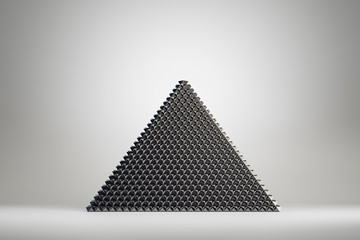 Abstract black pyramid on grey background
