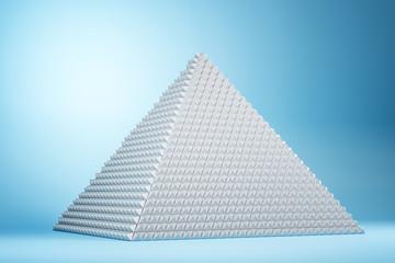 Creative white pyramid on blue background