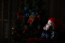 Little Girl In Red Hat Waiting For Santa