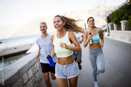 Group of young people jogging and running outdoors in nature - 282069797