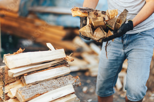 Printed kitchen splashbacks Firewood texture A pile of stacked firewood, prepared for heating the house. Gathering fire wood for winter or bonfire. Man holds fire wood in hands