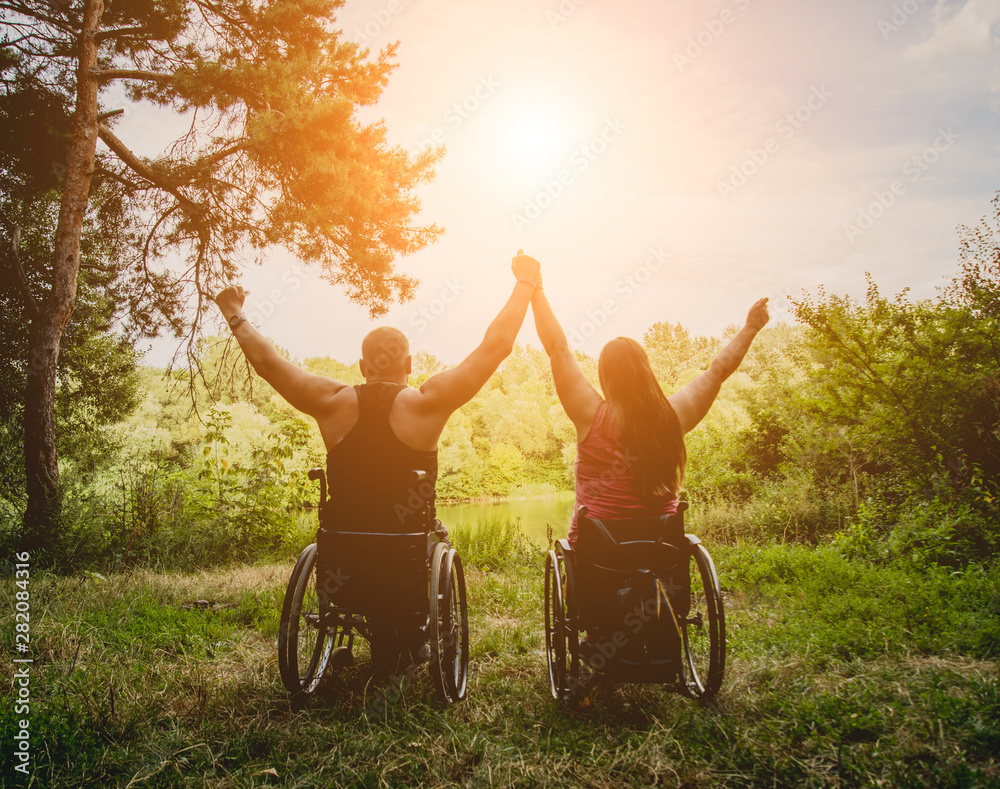 Fototapety, obrazy: Handicapped couple resting in the forest near lake. Wheelchairs in the forest on the natural background