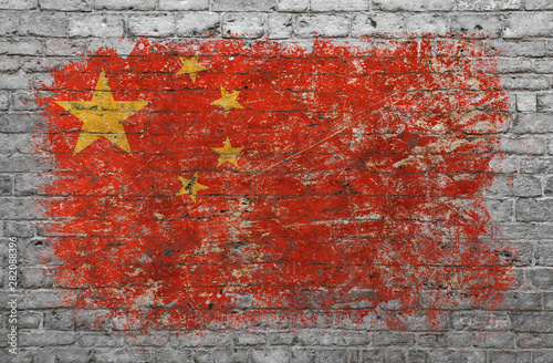 Poster Graffiti Flag of China painted on brick wall