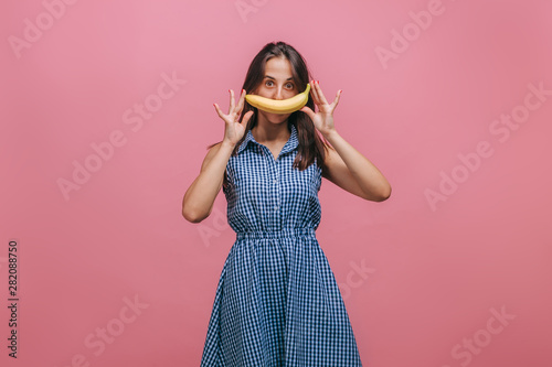 The girl with a banana like a smile - 282088750