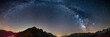 Leinwanddruck Bild - The Milky Way arch starry sky on the Alps, Massif des Ecrins, Briancon Serre Chevalier ski resort, France. Panoramic view high mountain range and glaciers, astro photography, stargazing