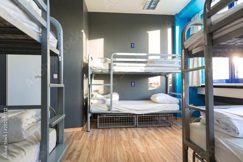 fototapeta na szkło Hostel interior, metal bunk beds and linen, nobody