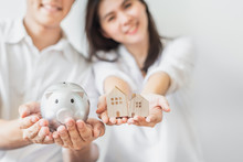 Couple Saving Money For Buying...