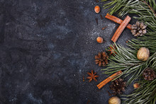 Beautiful Christmas Background With Copy Space For Your Text. Pine Branch, Cones, Cinnamon, Nuts Covered With Snow