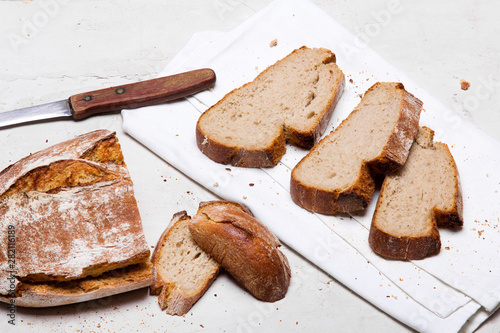 Tasty dark bread on white background, copy space Fotobehang