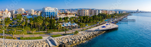 Obraz Republic of Cyprus. Limassol. The Seafront Of Limassol. The mediterranean coast. Tourist area with hotels. Panorama of Cyprus on a Sunny day. Rest on the Mediterranean. - fototapety do salonu