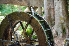 A Waterwheel In The Forest With Motion Blur Added.