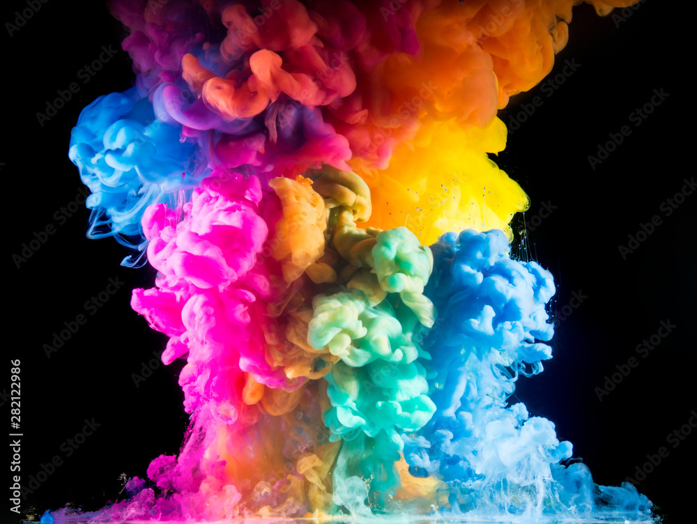 Fototapeta Colorful paint drops from above mixing in water. Ink swirling underwater
