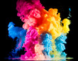 Colorful paint drops from above mixing in water. Ink swirling underwater