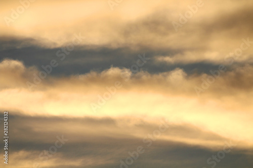 Poster de jardin Desert de sable Bright sky with clouds in the sun at sunset, natural colors, high contrast.