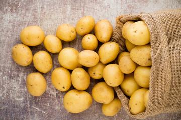 Sack of fresh raw potatoes ...