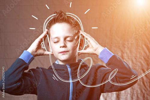 boy listening to music Doodle headphones and enjoy - 282129345