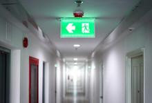 Hallway In Apartment With , Door Rooms In Dorm Fire Exit Green Light Sign