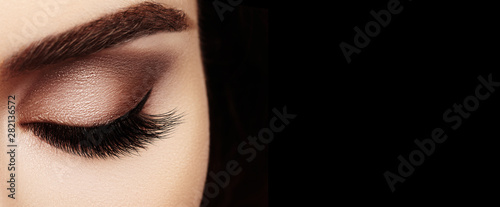 Obraz Beautiful Macro Female Eye with Extreme Long Eyelashes and Celebrate Makeup. Perfect Shape Make-up, Fashion Long Lashes - fototapety do salonu