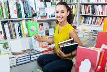 Female Student Shopping Books In Hard Cover