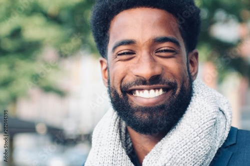 Beautiful happy man outside in the park Poster Mural XXL