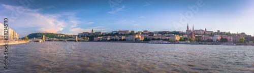 Fotografie, Obraz Budapest - June 21, 2019: Panoramic view of the Danube in Budapest, Hungary