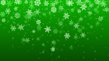 Christmas Background Of Complex Blurred And Clear Falling Snowflakes In Green Colors With Bokeh Effect
