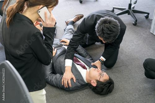 Valokuva  倒れるビジネスマン