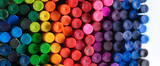 Fototapeta Tęcza - Box of crayons in a rainbow of colors background