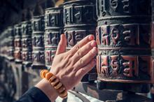 Spinning Buddhist Prayer Drums Or Prayer Wheels At A Monastery
