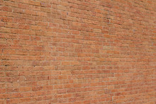Old Reddish Orange Brick Wall Background With Cracks And Worn Texture (angle View)
