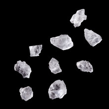 Crystals Of Salt Isolated On Black Background.