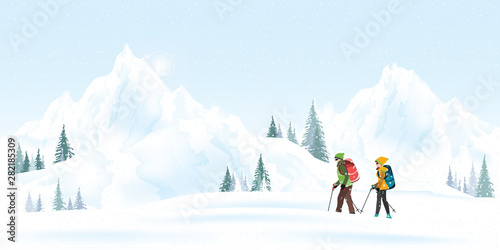 Fototapeta Mountain couple climbers with backpacks walking through heavy snow in winter season. obraz