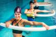 Leinwanddruck Bild - Aqua Aerobic Training in Water Sport Centre.