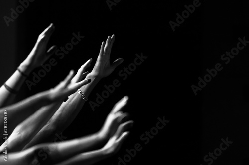 Photo  Arms raised in worship