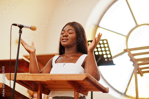 African american woman praying in the church фототапет