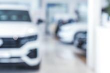 Blurred Interior Of Modern Car Showroom