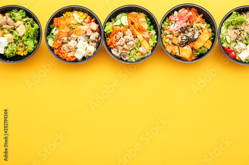 Fototapeta Many containers with delicious food on color background obraz