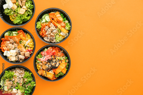 Fotografia  Many containers with delicious food on color background