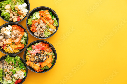 Recess Fitting India Many containers with delicious food on color background