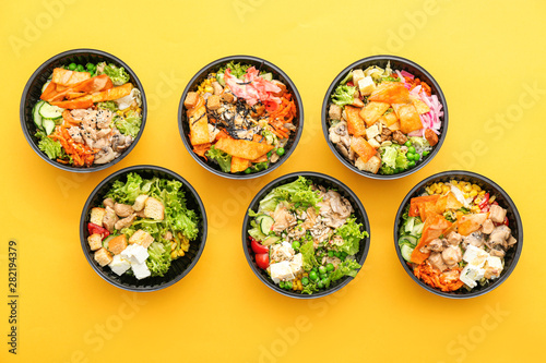 Photo Stands Asia Country Many containers with delicious food on color background