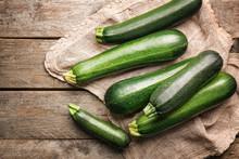 Fresh Zucchini Squashes On Wooden Background