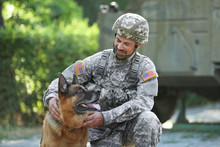 Soldier With Military Working Dog Outdoors