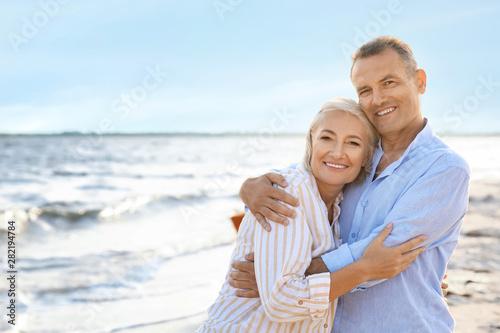 Happy mature couple at sea resort